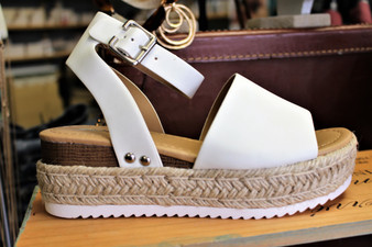 "Put some bounce in your step with these chic and comfortable wedges. Padded insole, ankle buckle 2"" platform"