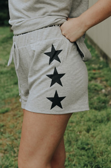 Emory Star Shorts  -Side Star Printed Knit Shorts  -Model is 5'6 and wears a size small