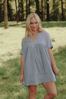 Sofia Babydoll Dress  - A gray/blue babydoll v neck dress  - Model is 5'7 and wears a size small