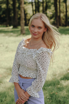 Carly Smocked Top  - A black and white floral smocked crop top  - Model is 5'7 and wearing a size small