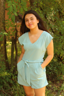 clara knotted romper  - a seafoam romper with a v neck  - model is wearing a small