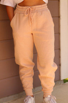 millie joggers  - a peachy, blush color joggers perfect for lounging or to dress up!!  - model is wearing a small