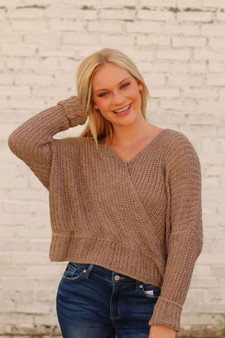 lila open back sweater  - a tan colored knitted sweater with an open back ; a little cropped  - model is wearing a size small