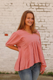 hannah babydoll top  - a pink high/low babydoll top  - model is wearing a small