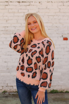 maggie leopard sweater  - a pink distressed leopard sweater, super cozy  - model is wearing a small