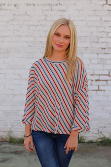 kari striped sweater  - a blue, red, and pink mix striped sweater: super lightweight  - model is wearing a small