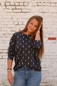 lightning bolt sweater  - a 3/4 length sleeve, gray sweatshirt with lightning bolts  - model is wearing a small