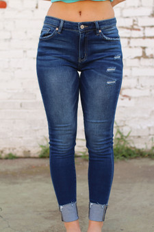 payton skinny jeans  - plain blue jeans with a hem at the bottom  - model is wearing a size 3
