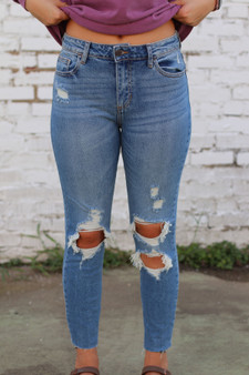 sadie distressed denim  - the cutest pair of jeans, fit true to size and are distressed around the knees!!  - model is wearing a size 3