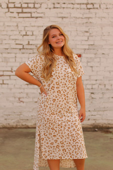 blythe maxi dress  - a white and tan leopard print maxi dress, higher in the front  - model is wearing a small