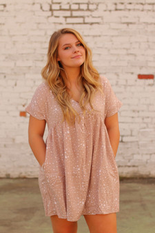 mason star dress  - a pink dress with white stars, pockets + it's a v neck  - model is wearing a medium