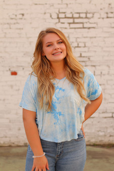 skye tie dye top  - a blue and white mix tie dye, a little cropped in length  - model is wearing a small