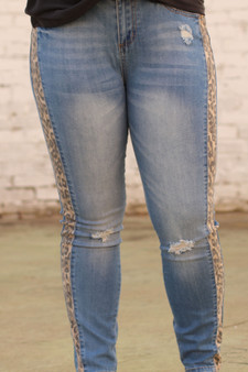 cheetah striped jeans  - blue jeans with cheetah stripes down both sides; with a little distressing  - model is wearing a medium