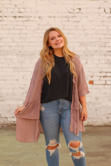 kinley ruffled cardigan  - a mauve/purple colored cardigan with ruffles at the bottom  - model is wearing a small