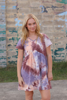 delaney tie dye dress  - a purple, pink, and peach mix tie dye dress  - model is wearing a small