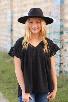 salem swiss dot top  - a black swiss dot top with ruffled sleeves, slightly oversized  - model is wearing a small