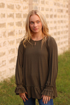 addison ruffled top  - an olive colored top with ruffles at the bottom and on the sleeves, perfect for layering  - model is wearing a size small