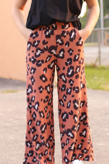 alli lounge pants  - rust colored leopard lounge pants  - model is wearing a small