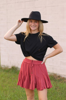 garner ruffled skirt  - a rust colored ruffled skirt with built in shorts  - model is wearing a small