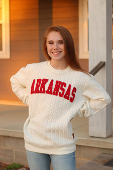 arkansas knitted sweater  - a white and red knitted sweater, super warm  - model is wearing a small