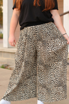 leopard palazzo pants  - very flowy, could be dressed up or down  - model is wearing a medium