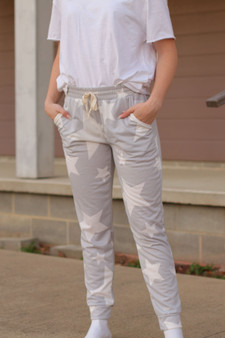 star joggers  - super cute white and gray star joggers, very lightweight  - model is wearing a size small