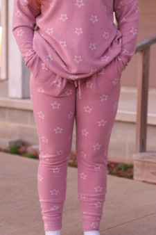 stella star joggers  - pink and white star joggers - also pictured: stella star sweatshirt  - model is wearing a size medium