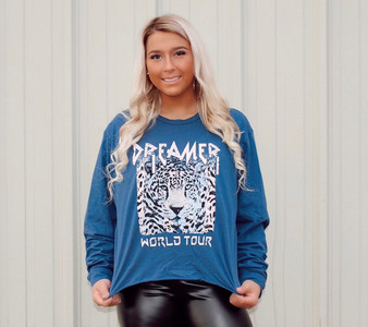 Our dreamer long sleeved graphic top is a must have! This top is semi cropped!