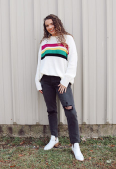 Our mardi gras tostriped sweater is so fun! Spice up your closet with this cute item!