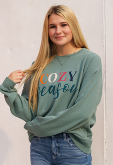 "A cute and soft green sweatshirt great for this ""cozy season""."