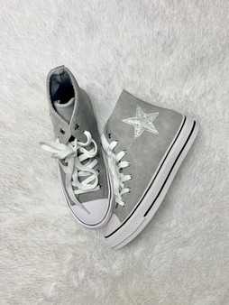 Grey high-top sneakers with a silver star on the side!