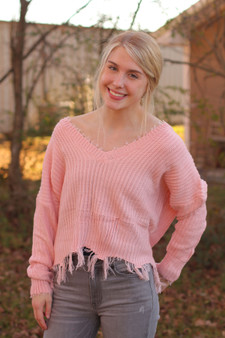 sophia distressed sweater  - a pink distressed sweater, super lightweight  - model is wearing a small