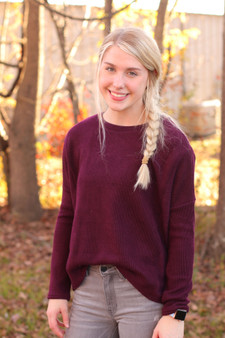 cora basic sweater  - a maroon/purple colored sweater, perfect for layering  - model is wearing a small