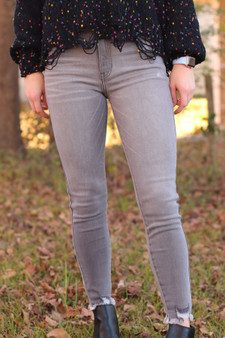 High Rise Ankle Skinny Jeans - Grey high rise skinny jeans with distressed bottoms.