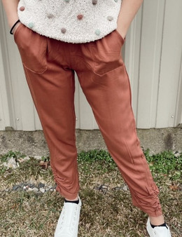 Maya Cinched Joggers - Silky orange joggers with an adjustable waist and cinched bottoms.