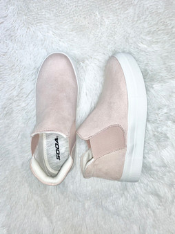 blush slip on sneakers with a slight wedge.