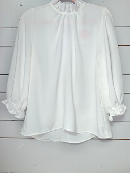 simply cute white top with ruffled sleeves and collar.