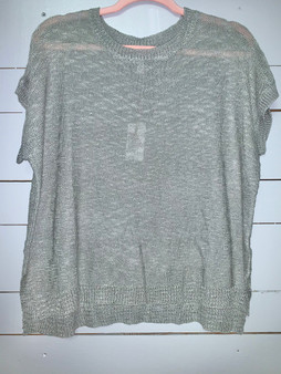 breathable knitted top with two inch slits on the sides.