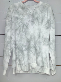 a very soft sweatshirt in a white and olive green tie dye.