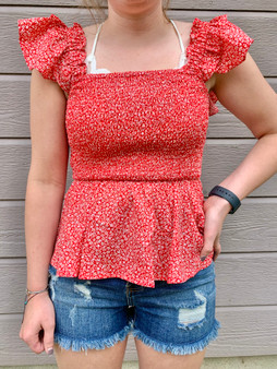 beckett floral top - red top with floral accent scattered. Very flattering and fitting.