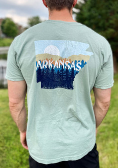 a sage green comfort colors tee with mountains on the back