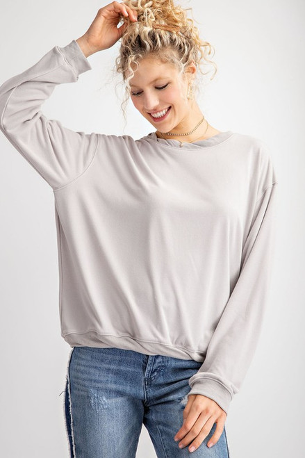 You know that shirt that you wish you could wear everyday--well this Twist it Pullover is just the one !  This slouchy silhouette, ultra soft, light gray pullover has a twisted neckline and hem to set it off.  long sleeve, ultra soft pullover.