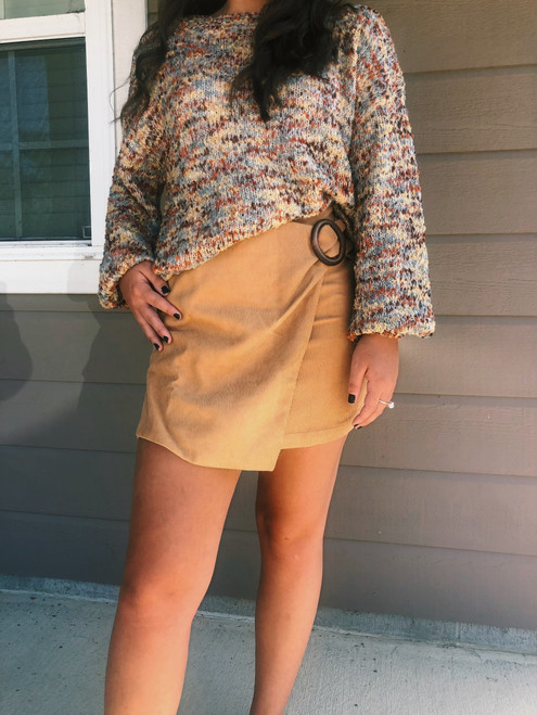 Show up styling and profiling in this sweet little corduroy Wrap mini skirt.  This cute and fashionable mini skirt  in mustard yellow features wrap around style with a wooden buckle accent and zippered back.  Made of 100 % polyester  and polyester lining