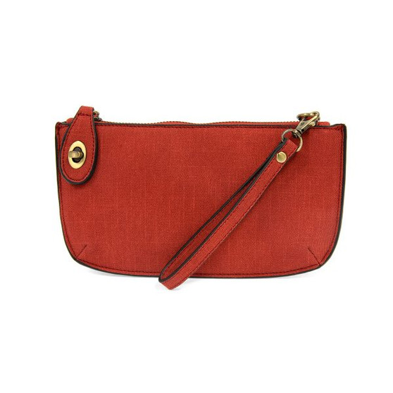 Get the elegant look of linen, no ironing needed! The Faux Linen Crossbody Wristlet Clutch from Joy Susan is a compact vegan leather carry-all that can do double duty as a stylish wallet, offering 6 interior card slots and both wristlet and removable cross-body straps. Comes in 10 colors to match any outfit or season.
