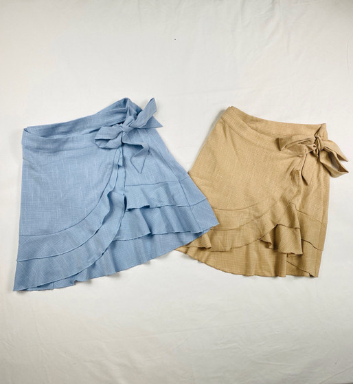 Ruffled scalloped skirt with a side tie, Taupe or chambray color blue 65% Polyester 30 % Rayon 5% spandex