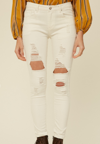 Angie Ripped Jeans  - Denim mid rise skinny jeans  - Washed, faded, destroyed, distressed, and ripped  - Rough leg opening hemming for easy cuffing