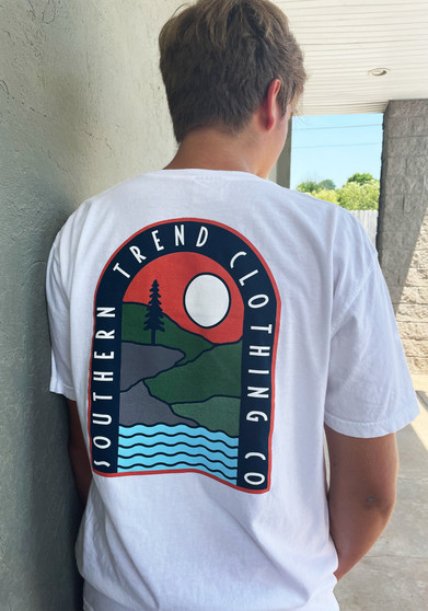 a white comfort colors tee with a scenic design on the back