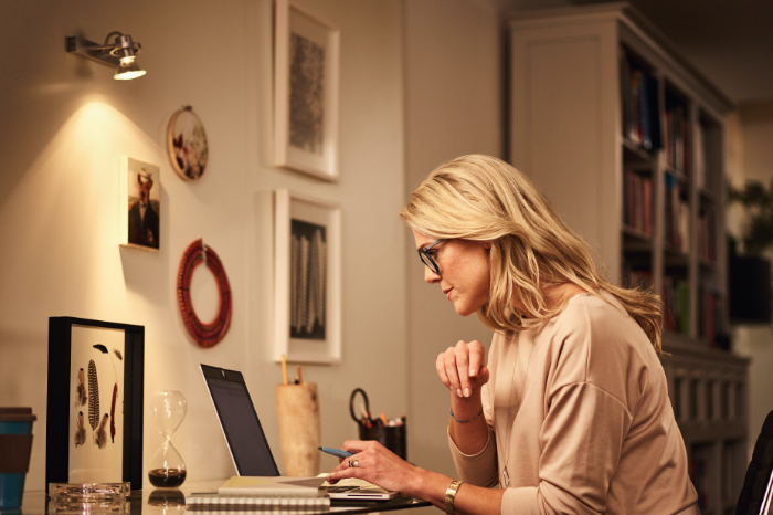 Lady working form home at her desk with led lighting in the room
