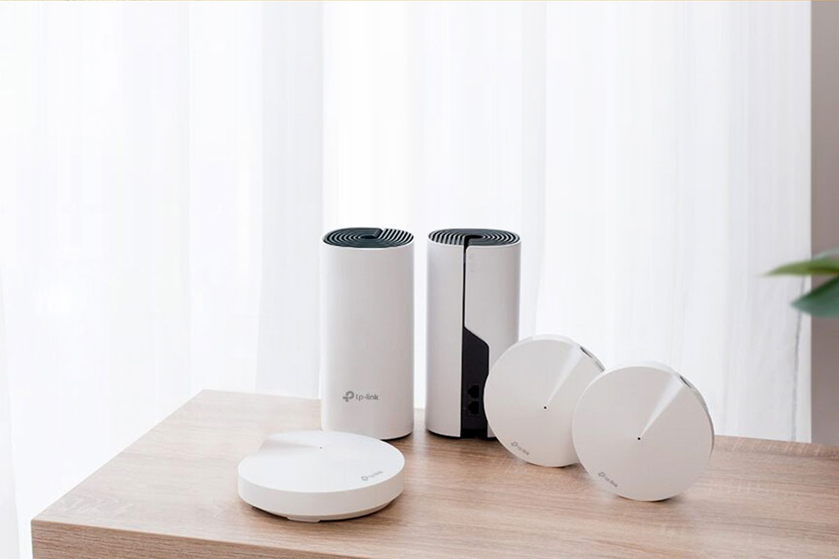 Tp-link wi-fi products displayed on a table