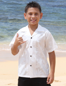 La'ele Hawaiian Kids White Shirt 100% Cotton Fabric Coconut shell buttons Machine Wash Cold Cool Iron Color: White Sizes: S - XL Made in Hawaii - USA